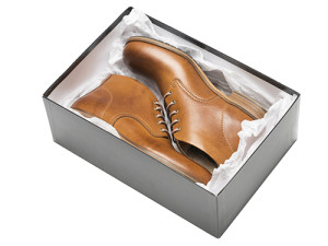 new brown shoes in box with wrapping paper